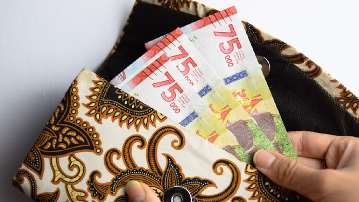 75.000 Banknote Indonesian Rupiah Money in Traditional Wallet