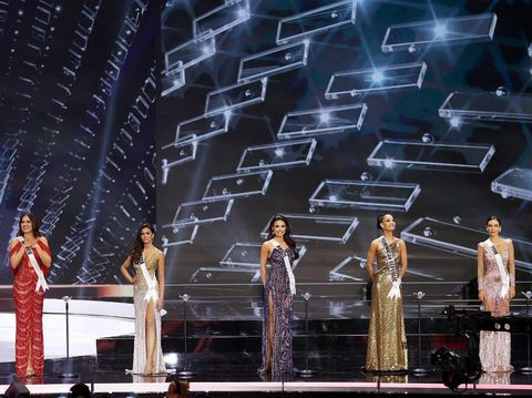 HOLLYWOOD, FLORIDA - MAY 16: (L-R) Miss Mexico, Andrea Meza, Miss India, Adline Castelino, Miss Brazil Julia Gama, Miss Dominican Republic, Kimberly Jimnez, and Miss Peru, Janick Maceta Del Castillo appears onstage at the Miss Universe 2021 Pageant at Seminole Hard Rock Hotel & Casino on May 16, 2021 in Hollywood, Florida.   Rodrigo Varela/Getty Images/AFP (Photo by Rodrigo Varela / GETTY IMAGES NORTH AMERICA / Getty Images via AFP)