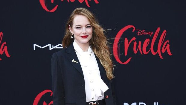 Emma Stone arrives at the premiere of