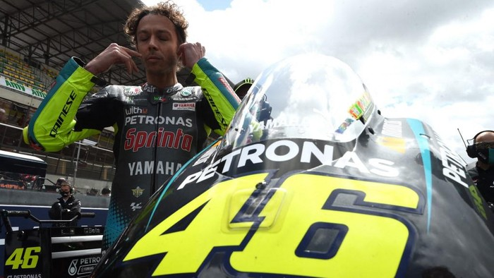 Petronas Yamaha SRTs Italian rider Valentino Rossi  waits on the grid, prior the French MotoGP, on May 16, 2021, in Le Mans, northwestern France. -  (Photo by JEAN-FRANCOIS MONIER / AFP)