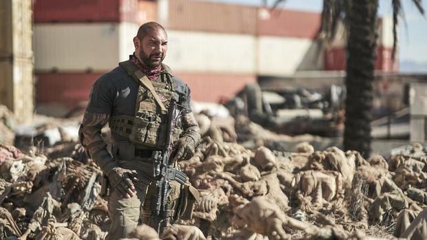 ARMY OF THE DEAD - (L-R) NORA ARNEZEDER as LILLY and DAVE BAUTISTA as SCOTT WARD. Cr: NETFLIX © 2021