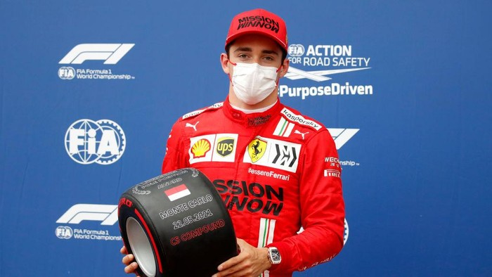 MONTE-CARLO, MONACO - MAY 22: Pole position qualifier Charles Leclerc of Monaco and Ferrari poses with his pole position award in parc ferme during qualifying prior to the F1 Grand Prix of Monaco at Circuit de Monaco on May 22, 2021 in Monte-Carlo, Monaco. (Photo by Sebastien Nogier - Pool/Getty Images)