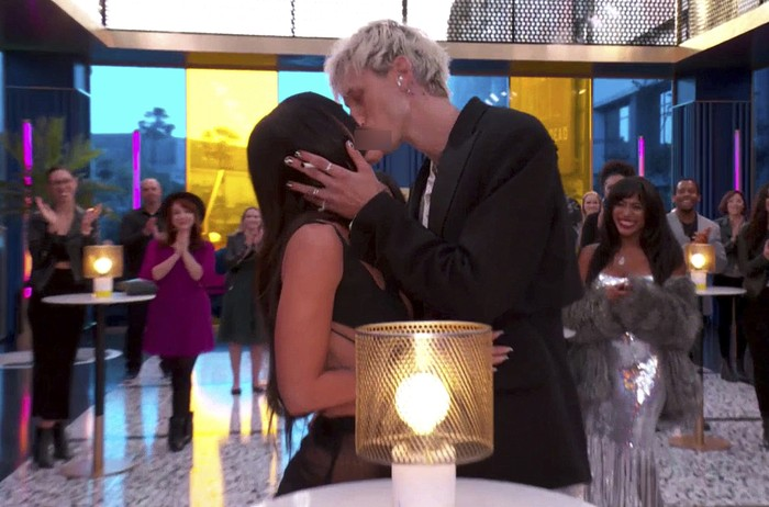 In this video image provided by NBC, Machine Gun Kelly and Megan Fox kiss before he accepts the top rock artist award during the Billboard Music Awards on Sunday, May 23, 2021. (NBC via AP)