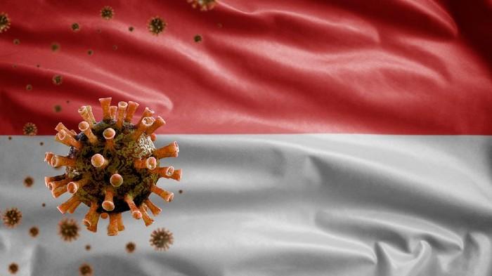 Indonesian flag waving and Coronavirus 2019 nCov concept. Asian outbreak in Indonesia, coronaviruses influenza as dangerous flu strain cases as a pandemic. Microscope virus Covid19 close up.