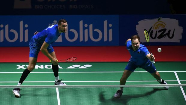JAKARTA, INDONESIA - JULY 03:  Vladimir Ivanov and Ivan Sozonov of Russia compete against Kasper Antonsen and Niclas Nohr of Denmark during the Men's Doubles Round 1 match on day one of the Blibli Indonesia Open at Istora Gelora Bung Karno on July 3, 2018 in Jakarta, Indonesia.  (Photo by Robertus Pudyanto/Getty Images)