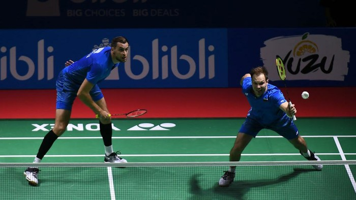 JAKARTA, INDONESIA - JULY 03:  Vladimir Ivanov and Ivan Sozonov of Russia compete against Kasper Antonsen and Niclas Nohr of Denmark during the Mens Doubles Round 1 match on day one of the Blibli Indonesia Open at Istora Gelora Bung Karno on July 3, 2018 in Jakarta, Indonesia.  (Photo by Robertus Pudyanto/Getty Images)