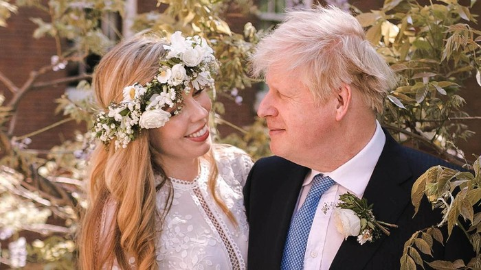 LONDON, UNITED KINGDOM - MAY 29: (Alternate crop of #1233183330)  In this handout image released by 10 Downing Street, Prime Minister Boris Johnson poses with his wife Carrie Johnson in the garden of 10 Downing Street following their wedding at Westminster Cathedral, May 29, 2021 in London, England. The secretly planned wedding took place in a small ceremony on Saturday afternoon. Johnson is the first Prime Minister to get married while in office in nearly 200 years. (Photo by Rebecca Fulton / Downing Street via Getty Images)