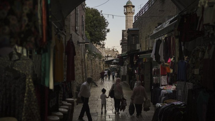 Ultra-Orthodox Jewish men walk at night in Jerusalem's Old City, Saturday, May 29, 2021, days after a cease-fire was reached in the 11-day war between Gaza's Hamas rulers and Israel. (AP Photo/Felipe Dana)