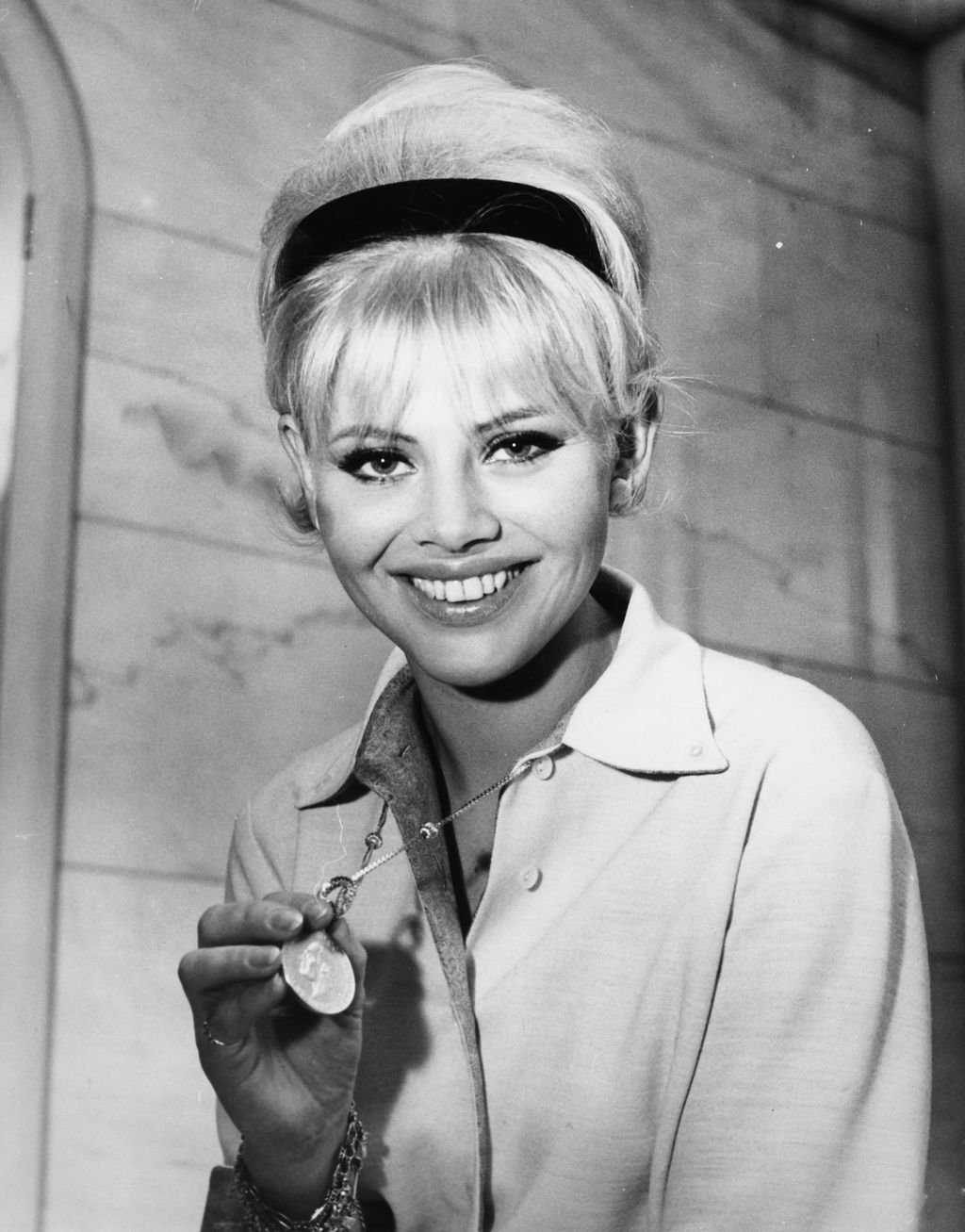 Portrait of actress Britt Ekland, soon to star in the film 'Those Magnificent Men and their Flying Machines', at a press conference at the Savoy Hotel, London, January 27th 1964. (Photo by Dennis Oulds/Central Press/Getty Images)