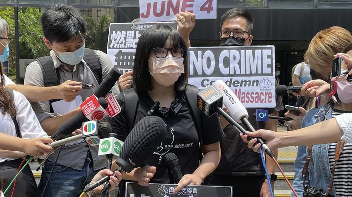FILE - In this May 6, 2021, file photo, Chow Hang Tung, the vice chair of The Hong Kong Alliance in Support of Patriotic Democratic Movements of China, speaks to media outside a court in Hong Kong. Hong Kong police on Friday, June 4, arrested the committee member that organizes the city's annual June 4 museum and candlelight vigil, on the 32nd anniversary of a bloody military crackdown on pro-democracy protesters in Beijing's Tiananmen Square, according to local media reports. (AP Photo/Rafael Wober, File)