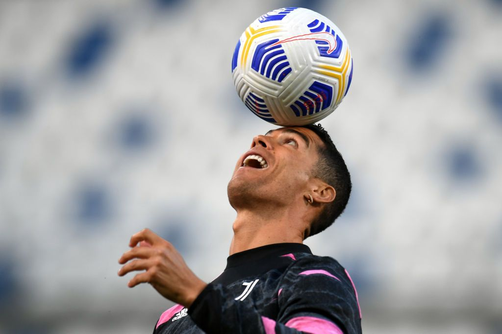 REGGIO NELL'EMILIA, ITALY - MAY 12: Cristiano Ronaldo of Juventus warms up prior to the Serie A match between US Sassuolo and Juventus at Mapei Stadium - Città del Tricolore on May 12, 2021 in Reggio nell'Emilia, Italy. Sporting stadiums around Italy remain under strict restrictions due to the Coronavirus Pandemic as Government social distancing laws prohibit fans inside venues resulting in games being played behind closed doors.  (Photo by Alessandro Sabattini/Getty Images)