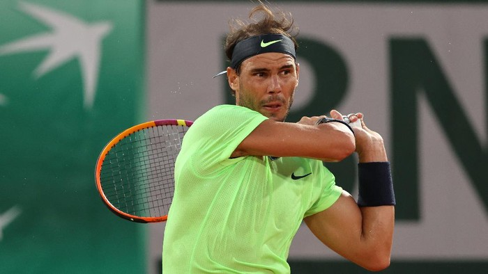 PARIS, FRANCE - JUNE 03:  Rafael Nadal of Spain plays a backhand  during his mens second round match against Richard Gasquet of France during day five of the 2021 French Open at Roland Garros on June 03, 2021 in Paris, France. (Photo by Clive Brunskill/Getty Images)