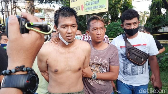 Penusuk polantas sempat dibawa ke TKP penyerangan di Pos Lantas Angkatan 66, Palembang (Prima Syahbana/detikcom)