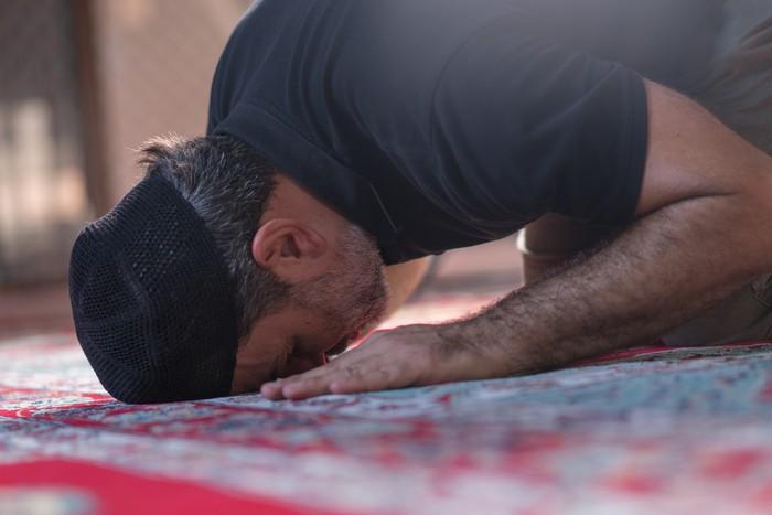 Muslim mature men prayer in mosque