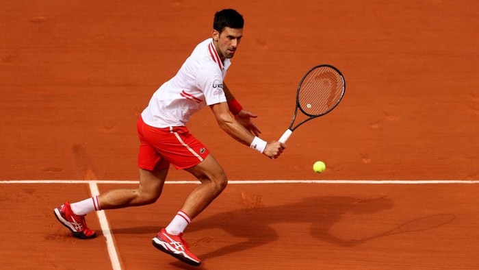 PARIS, FRANCE - JUNE 07: Novak Djokovic of Serbia plays a backhand volley in their mens singles fourth round match against Lorenzo Musetti of Italy during day nine of the 2021 French Open at Roland Garros on June 07, 2021 in Paris, France. (Photo by Clive Brunskill/Getty Images)