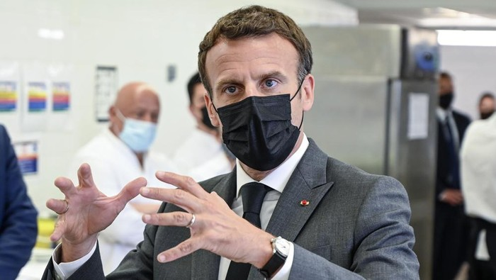 French President Emmanuel Macron talks to journalists Tuesday June 8, 2021 at the Hospitality school in Tain-lHermitage, southeastern France. French President Emmanuel Macron has been slapped in the face by a man during a visit in a small town of southeastern France, Macrons office confirmed. (Philippe Desmazes, Pool via AP)