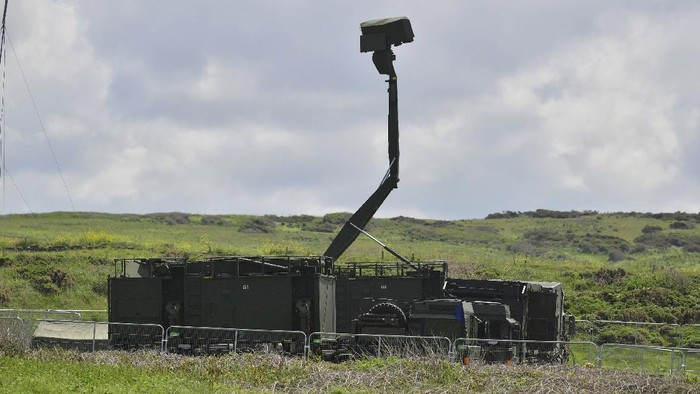 Mobile radar station set up at the National Trust car park in Godrevy, near St Ives, southern England, ahead of the upcoming G7 summit, Tuesday June 8, 2021. Three days of talks with G7 world leaders are expected to focus on the global recovery from the pandemic and a commitment to vaccinating the global population by the end of 2022. (Ben Birchall/PA via AP)