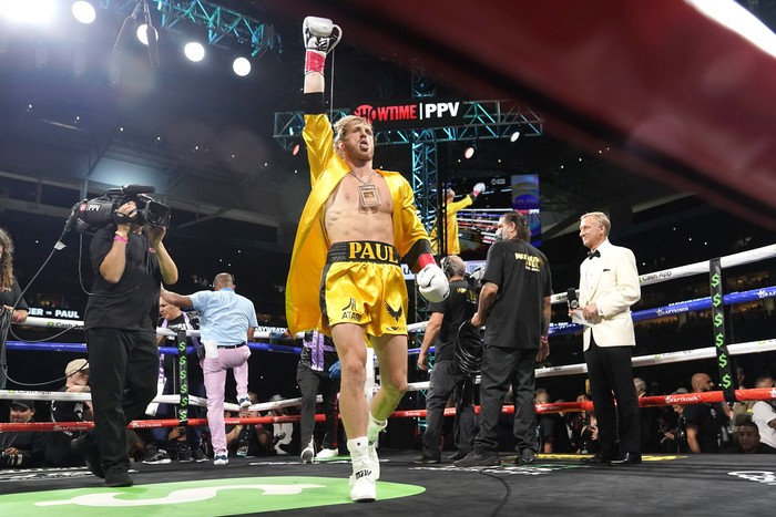 Logan Paul walks into the ring for an exhibition boxing match against Floyd Mayweather at Hard Rock Stadium, Sunday, June 6, 2021, in Miami Gardens, Fla. (AP Photo/Lynne Sladky)
