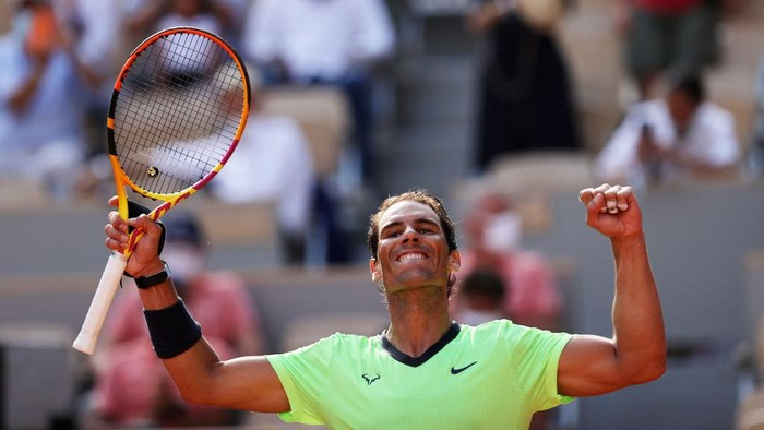 PARIS, FRANCE - JUNE 09: Rafael Nadal of Spain celebrates match point and victory in his Mens Singles Quarter-Final match against Diego Schwartzman of Argentina during Day Eleven of the 2021 French Open at Roland Garros on June 09, 2021 in Paris, France. (Photo by Clive Brunskill/Getty Images)
