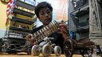 Keren! Miniatur Kapal Pinisi Dibuat dari Koran Bekas Lho