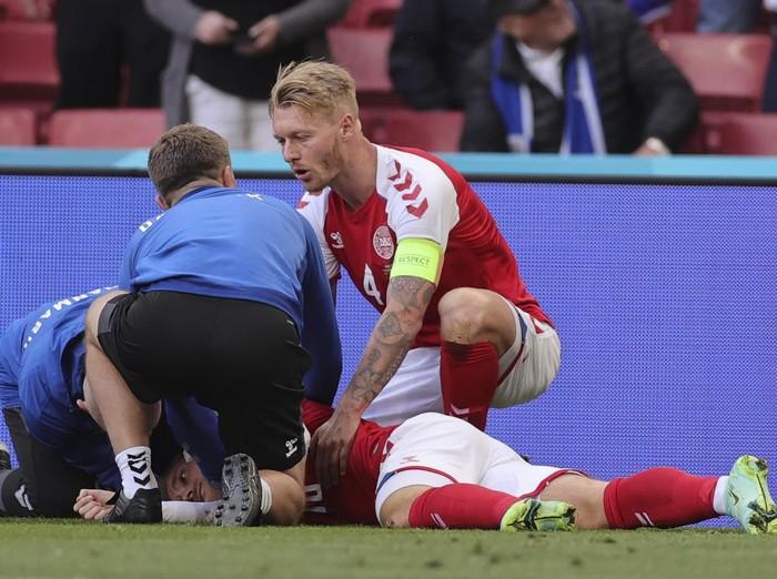 Denmarks Christian Eriksen lays on the ground after collapsing during the Euro 2020 soccer championship group B match between Denmark and Finland at Parken stadium in Copenhagen, Denmark, Saturday, June 12, 2021. (Friedemann Vogel/Pool via AP)