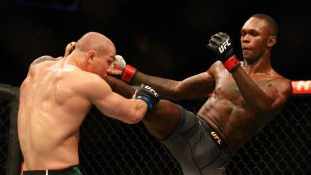 GLENDALE, ARIZONA - JUNE 12: Israel Adesanya of Nigeria fights Marvin Vettori of Italy during their UFC 263 middleweight championship match at Gila River Arena on June 12, 2021 in Glendale, Arizona. (Photo by Christian Petersen / GETTY IMAGES NORTH AMERICA / Getty Images via AFP)