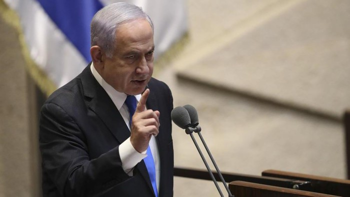 Israels outgoing prime minister Benjamin Netanyahu speaks during a Knesset session in Jerusalem Sunday, June 13, 2021. Bennett is expected later Sunday to be sworn in as the countrys new prime minister, ending Prime Minister Benjamin Netanyahus 12-year rule. (AP Photo/Ariel Schali22