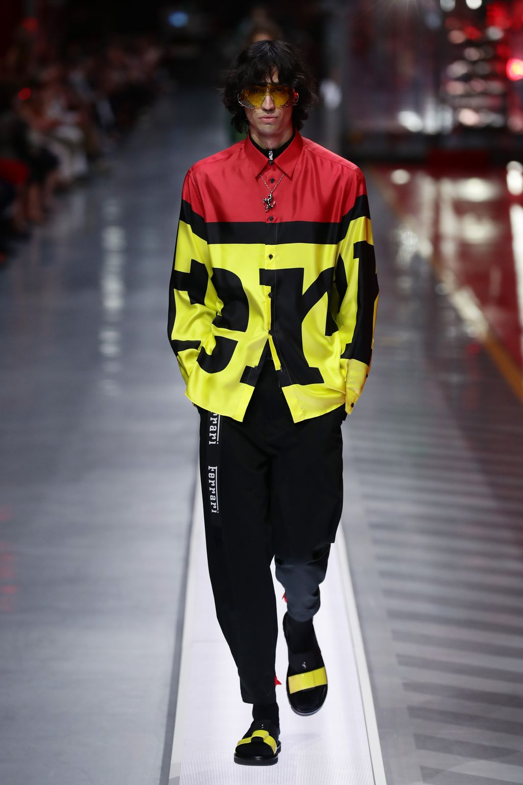 MARANELLO, ITALY - JUNE 13:  A model walks the runway at the fashion debut of the first co-ed Ferrari collection at Ferrari Factory on June 13, 2021 in Maranello, Italy. (Photo by Vittorio Zunino Celotto/Getty Images)
