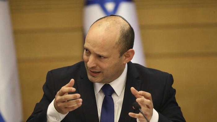 Israels new prime minister Naftali Bennett holds a first cabinet meeting in Jerusalem Sunday, June 13, 2021. Israels parliament has voted in favor of a new coalition government, formally ending Prime Minister Benjamin Netanyahus historic 12-year rule. Naftali Bennett, a former ally of Netanyahu became the new prime minister (AP Photo/Ariel Schalit)