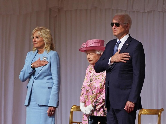 WINDSOR, ENGLAND - JUNE 13:   First Lady Jill Biden, Queen Elizabeth II and US President Joe Biden view the ranks of a Guard of Honour formed of The Queens Company First Battalion Grenadier Guards at Windsor castle on June 11, 2021 in Windsor, England.  Queen Elizabeth II hosts US President, Joe Biden and First Lady, Dr Jill Biden, at Windsor Castle. The President arrived from Cornwall where he attended the G7 Leaders Summit and will travel on to Brussels for a meeting of NATO Allies and later in the week he will meet President of Russia, Vladimir Putin. (Photo by Richard Pohle-WPA Pool/Getty Images)