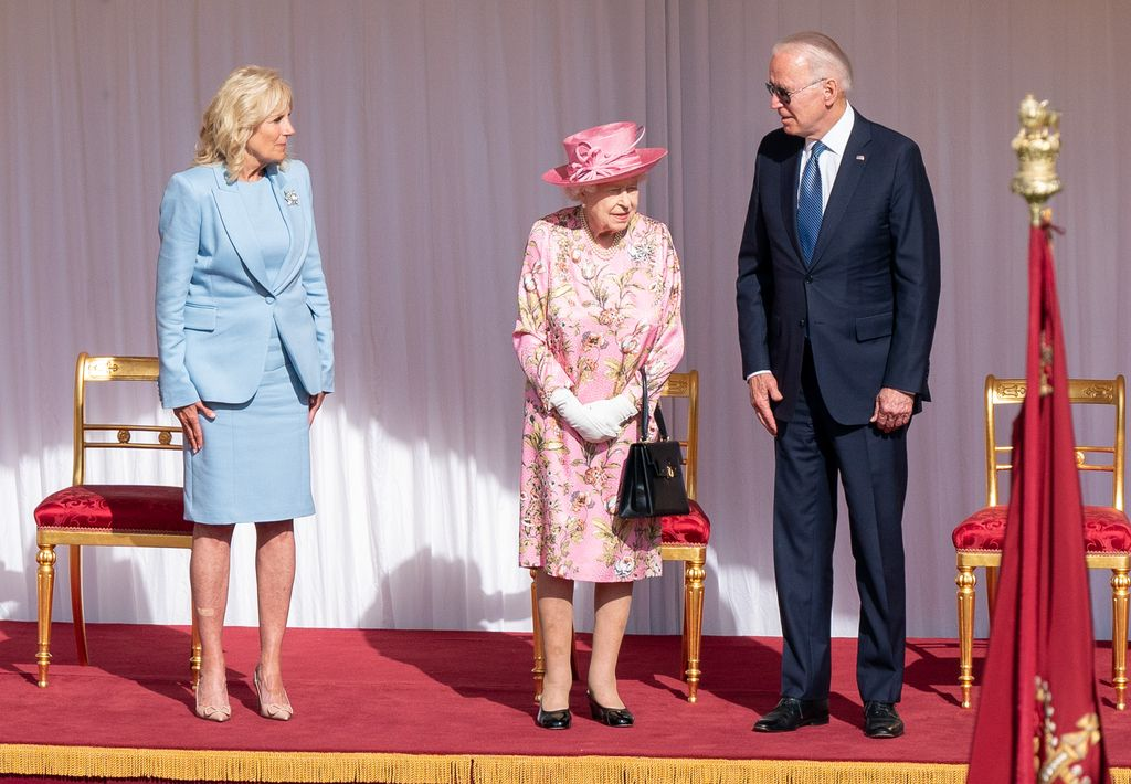 WINDSOR, ENGLAND - JUNE 13:   First Lady Jill Biden, Queen Elizabeth II and US President Joe Biden view the ranks of a Guard of Honour formed of The Queen's Company First Battalion Grenadier Guards at Windsor castle on June 11, 2021 in Windsor, England.  Queen Elizabeth II hosts US President, Joe Biden and First Lady, Dr Jill Biden, at Windsor Castle. The President arrived from Cornwall where he attended the G7 Leader's Summit and will travel on to Brussels for a meeting of NATO Allies and later in the week he will meet President of Russia, Vladimir Putin. (Photo by Richard Pohle-WPA Pool/Getty Images)