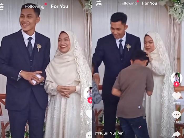 Kisah viral pengantin bagi-bagi amplop di atas pelaminan.