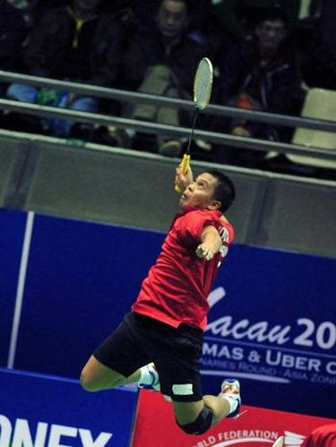 Indonesia's Markis Kido jumps for a return as he and partner Hendra Setiawan (not pictured) play against Malaysia's Lim Khim Wah and Teo Kok Siang during the men's doubles component of the Thomas Cup badminton tournament in Macau on February 18, 2012.  AFP PHOTO / Antony DICKSON (Photo by ANTONY DICKSON / AFP)