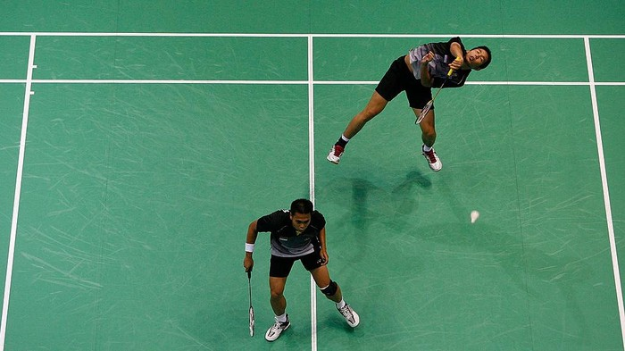BEIJING - AUGUST 12:  Markis Kido and Setiawan Hendra of Indonesia compete against Guo Zhendong and Xie Zhongbo of China in the men's doubles badminton held at the Beijing University of Technology Gymnasium during day 4 of the Beijing 2008 Olympic Games on August 12, 2008 in Beijing, China.  (Photo by Harry How/Getty Images)