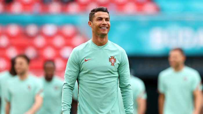 BUDAPEST, HUNGARY - JUNE 14: Cristiano Ronaldo smiles during the Portugal Training Session ahead of the Euro 2020 Group F match between Hungary and Portugal at Puskas Arena on June 14, 2021 in Budapest, Hungary. (Photo by Alex Pantling/Getty Images)