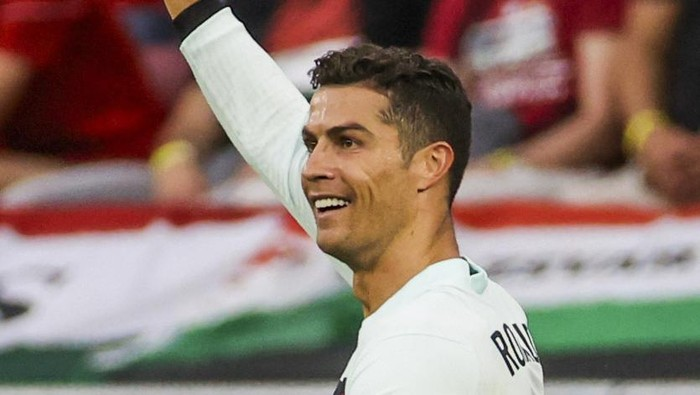 Portugals Cristiano Ronaldo scores his second goal during the Euro 2020 soccer championship group F match between Hungary and Portugal at the Ferenc Puskas stadium in Budapest, Hungary, Tuesday, June 15, 2021. (Bernadett Szabo/Pool via AP)