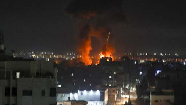 Explosions light-up the night sky at Khan Yunis in the southern Gaza Strip, as Israeli forces shell the Palestinian enclave, early on June 16, 2021. (Photo by SAID KHATIB / AFP)