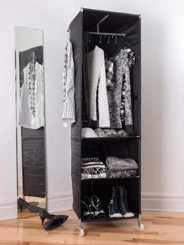 Mobile clothes organizer with black and white clothing and shoes.