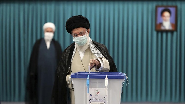 In this picture released by the official website of the office of the Iranian supreme leader, Supreme Leader Ayatollah Ali Khamenei casts his ballot for the presidential elections, in Tehran, Iran, Friday, June 18, 2021. Iran began voting Friday in a presidential election tipped in the favor of a hard-line protege of Supreme Leader Ayatollah Ali Khamenei, fueling public apathy and sparking calls for a boycott in the Islamic Republic. (Office of the Iranian Supreme Leader via AP)