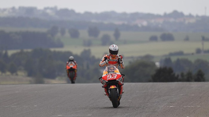 HOHENSTEIN-ERNSTTHAL, GERMANY - JUNE 20:  Marc Marquez of Spain and Repsol Honda Team cuts the finish lane and celebrates the victory during the MotoGP race during the MotoGP of Germany - Race at Sachsenring Circuit on June 20, 2021 in Hohenstein-Ernstthal, Germany. (Photo by Mirco Lazzari gp/Getty Images)