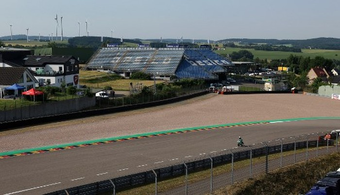 Empty stands can be seen during a free practice session of the German motorcycle Grand Prix at the Sachsenring racing circuit in Hohenstein-Ernstthal near Chemnitz, eastern Germany, on June 19, 2021. (Photo by Ronny Hartmann / AFP)