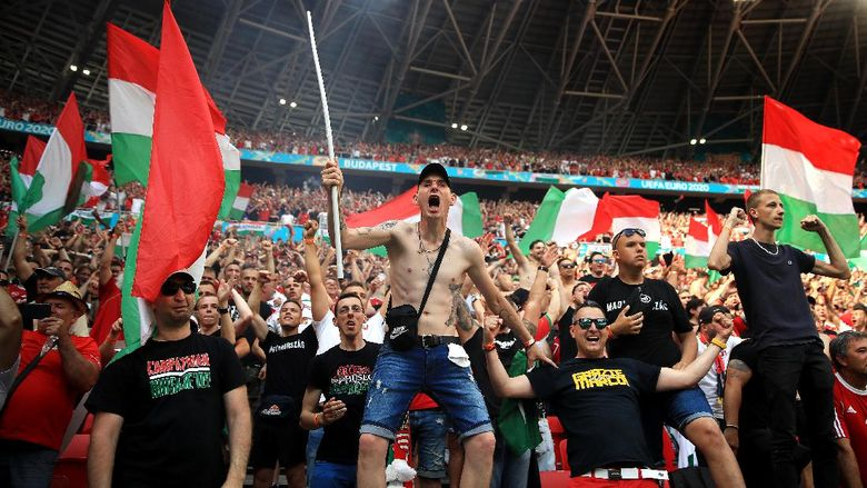 BUDAPEST, HUNGARY - JUNE 19: Fans of Hungary celebrate their first goal during the UEFA Euro 2020 Championship Group F match between Hungary and France at Puskas Arena on June 19, 2021 in Budapest, Hungary. (Photo by Alex Pantling/Getty Images)