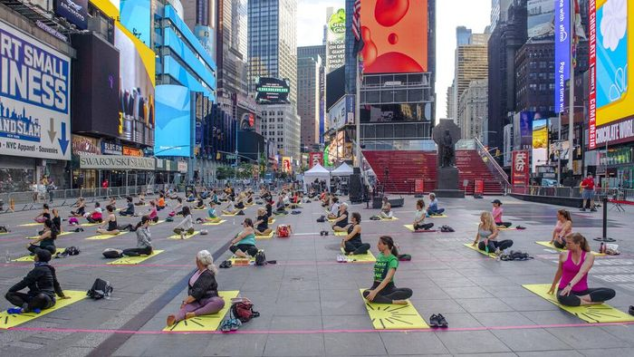 Krista Smithen participates in Solstice in Times Square: Mind Over Madness Yoga, an annual all-day outdoor yoga event in New Yorks Times Square, Sunday, June 20, 2021. (AP Photo/Brittainy Newman)