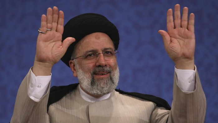 Irans new President-elect Ebrahim Raisi waves to participants at the conclusion of his press conference in Tehran, Iran, Monday, June 21, 2021. Raisi said Monday he wouldnt meet with President Joe Biden nor negotiate over Tehrans ballistic missile program and its support of regional militias, sticking to a hard-line position following his landslide victory in last weeks election. (AP Photo/Vahid Salemi)