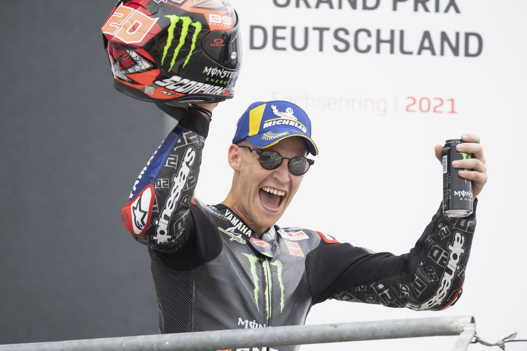HOHENSTEIN-ERNSTTHAL, GERMANY - JUNE 20: Fabio Quartararo of France and Monster Energy Yamaha MotoGP Team celebrates the third place on the podium during the MotoGP race during the MotoGP of Germany - Race at Sachsenring Circuit on June 20, 2021 in Hohenstein-Ernstthal, Germany. (Photo by Mirco Lazzari gp/Getty Images)