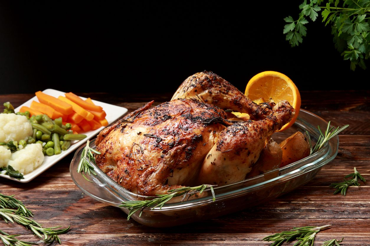 Traditional English Roast Chicken marinated with Herbs and Spices served with Roast Potatoes and Vegetables as a side dish