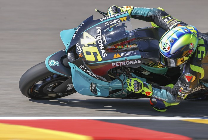 Italian Valentino Rossi of Petronas Yamaha SRT speeds at a free training session of the MotoGP  in Hohenstein-Ernstthal, Germany, Friday, June 18, 2021. (Jan Woitas/dpa via AP)