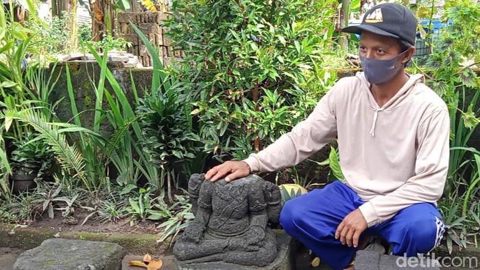 Batu arca tanpa kepala yang ditemukan saat gali septik tank 2017 silam di Desa Taskombang, Klaten