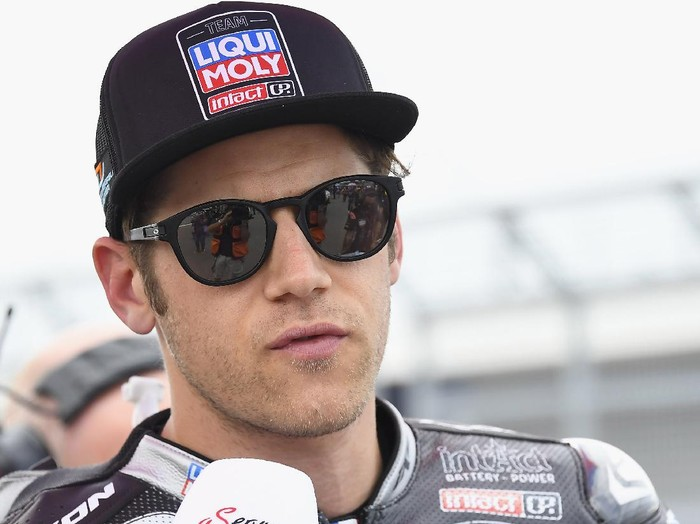HOHENSTEIN-ERNSTTHAL, GERMANY - JUNE 20:  Marcel Schrotter of Germany and Liqui Moly Intact GP speaks with journalists on the grid during the Moto2 race during the MotoGP of Germany - Race at Sachsenring Circuit on June 20, 2021 in Hohenstein-Ernstthal, Germany. (Photo by Mirco Lazzari gp/Getty Images)