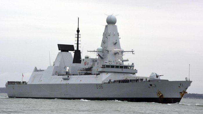 FILE - This March 20, 2020 file photo shows HMS Defender in Portsmouth, England. The Russian military says its warship has fired warning shots and a warplane dropped bombs to force the British destroyer from Russias waters near Crimea in the Black Sea. The incident on Wednesday June 23, 2021, marks the first time since the Cold War era when Moscow used live ammunition to deter a NATO warship, reflecting soaring Russia-West tensions. (Ben Mitchell/PA via AP, File)
